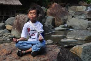 stockvault-boy-in-meditation116575